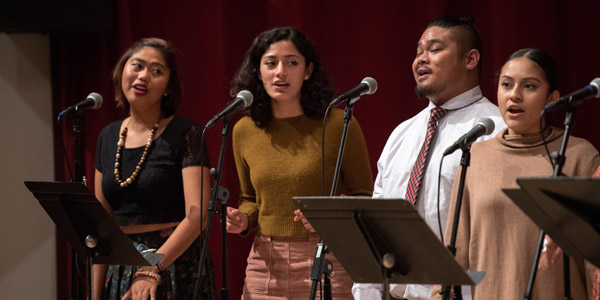 Four Students singing in a performance